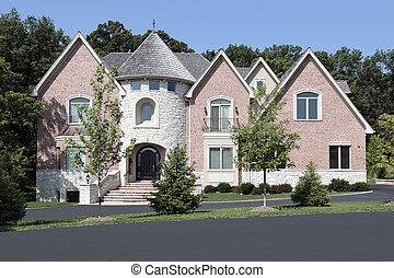 Luxury brick home with turret
