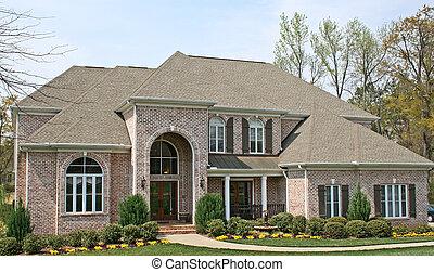 luxury brick house in american upscale community
