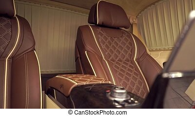 Luxury brown leather and yellow trimming car interior with installed tablet, pan