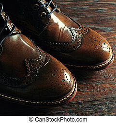 luxury brown shoes on wood background - A pair of luxury...