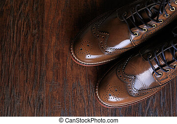 luxury brown shoes on wood background. - A pair of luxury...