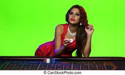 Luxury brunette girl play with chip - Luxury brunette girl...