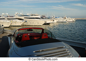 Luxury car and yacht - Luxury sports car and yachts in the...