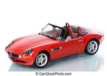 Luxury car - A replica of a lux red car, shoot against very...