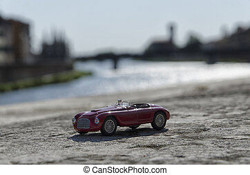 Luxury car with Pisa on the background