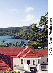 luxury caribbean st. vincent and the grenadines island mansion villa house with view of bequia island industry bay crescent beach in the caribbean sea with tropical garden