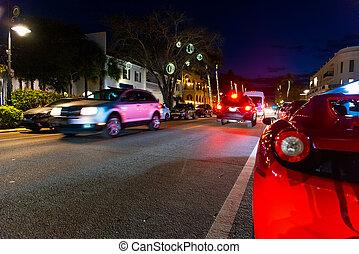 Luxury cars in Naples main street at night