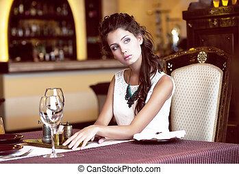 Luxury. Classy Romantic Woman in Restaurant. Expectancy