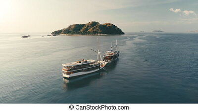 Luxury cruise ships at ocean panorama aerial. Island at nature seascape. Traveling at calm blue water on cruiseliner. Marine holiday. Vacation on liner at sea bay. Harbor at mountain coast. Relaxation