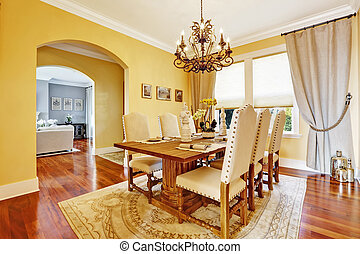 Luxury dining room with carved wood table