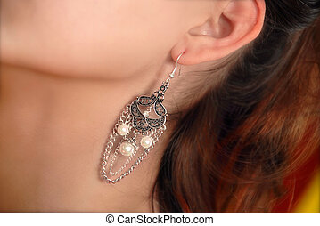earring - luxury earring in young girl ear closeup