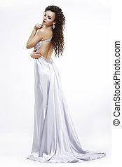 Luxury. Elegance. Glamorous Woman in Light Shiny Dress. Dolce Vita