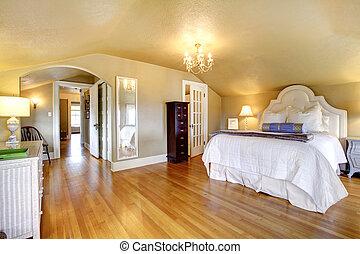Luxury elegant gold bedroom interior with white bedding.