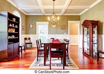 Luxury elegant green dining room with cherry floor.