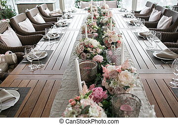 Luxury, elegant wedding reception table arrangement, floral centerpiece. Professional work florists. Decoration family dinner