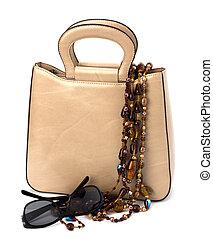 Luxury female handbag isolated on white background