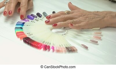 Luxury female hands with red manicure. Senior woman wrinkled...