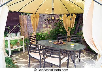 Luxury garden furniture at green yard