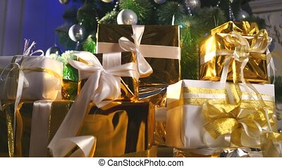 luxury gift boxes under Christmas tree,