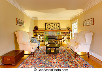 Luxury gold livinf room with two white sofas