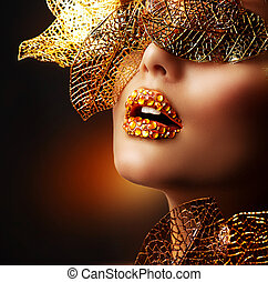 Luxury Golden Makeup. Beautiful Professional Holiday Make-up...