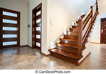 Luxury hallway with woden stairs to bedroom on teh floor