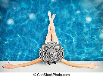 Luxury holiday - Woman with straw hat in the pool