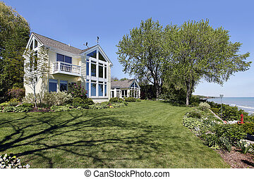 Luxury home along lakeshore - Rear view of luxury home along...