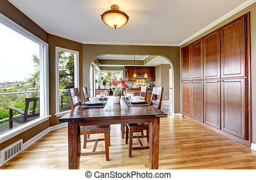 Luxury home dining room with wood and green.