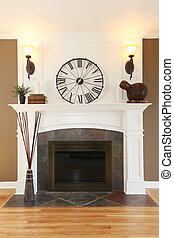 Luxury home white fireplace with stone and clock.