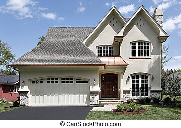 Front view of luxury home with arched entry