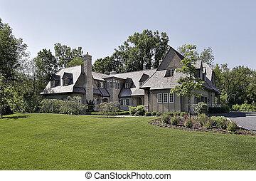 Luxury home with cedar shake roof