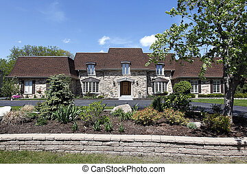 Luxury home with stone landscaping