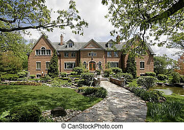 Luxury home with stone walkway - Large brick home with stone...