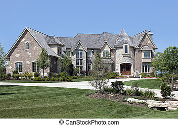 Luxury brick and stone home with turret