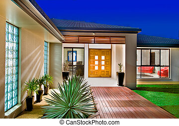 Luxury home with wooden front doors and polished wooden ...