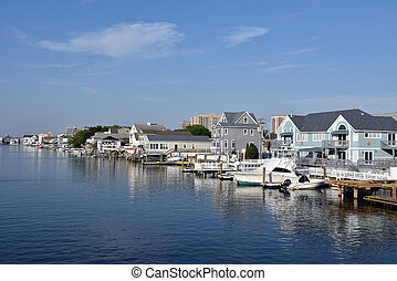 Luxury homes line a New England waterway