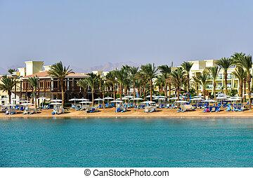 Luxury hotel beach against blue sky