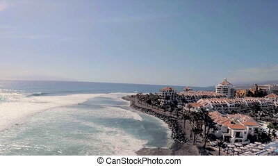 Luxury hotels and pools on the blue sea and mountains. Tenerife. Aerial view.