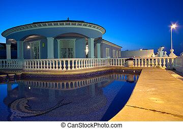 luxury house and pool at dark night
