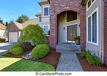 Luxury house entrance porch with brick trim