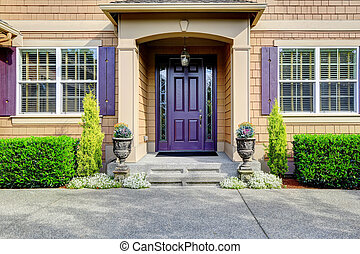 Luxury house exterior. Entrance porch with purple door -...
