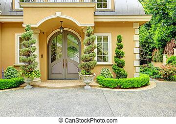 Luxury house exterior. Front door - Beautiful house...
