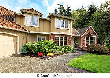 Luxury house exterior with brick trim