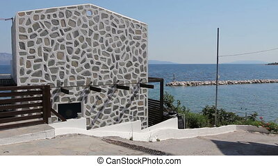 Luxury house has colored edges of stones in artistic wall design, texture
