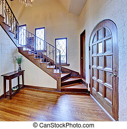 Luxury house interior. Entrance hallway with staircase