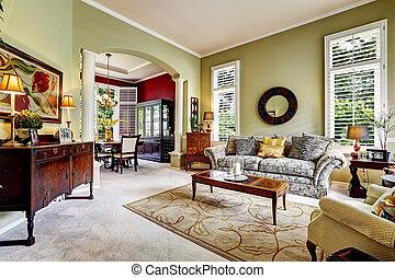 Luxury house interior. Light green family room