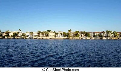 Luxury houses at the canal in Tampa with boats