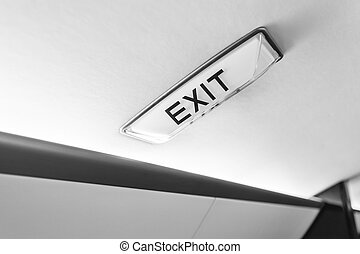 interior in business aircraft with exit sign