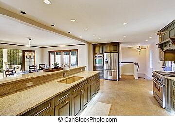 Luxury khaki kitchen interior with spaciuos dining area